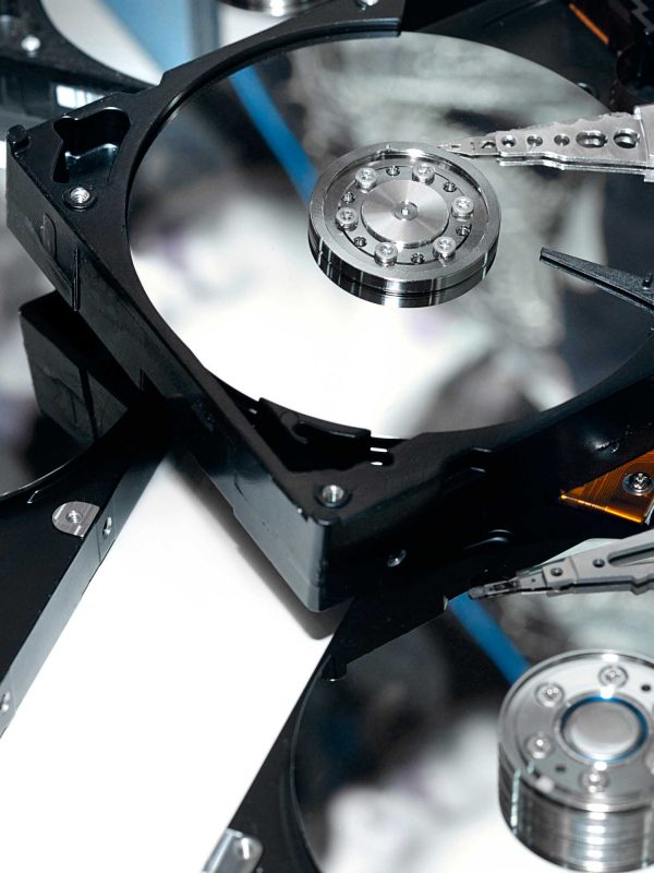 Close-up of a few open HDDs on white background without covers Information storage Data recovery service concept